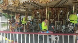 Special needs adults having fun riding a carousel
