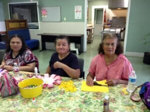 three special needs women having fun at Easter party