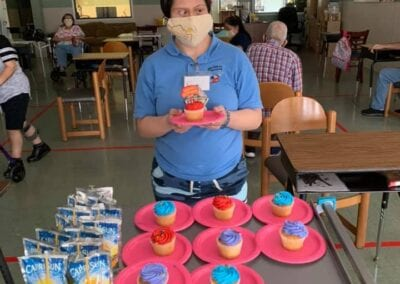 Woman with special needs holding cupcake at a birthday party