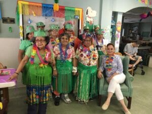 Special needs adults enjoying a Hawaiian themed party