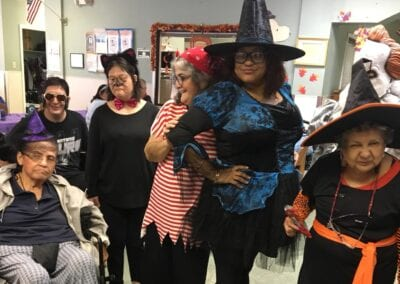 Nurse having fun with special needs adults at a Halloween party