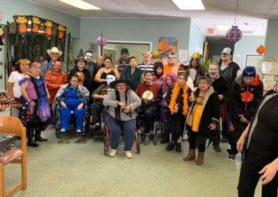 Group photo at AlamoCare Halloween party