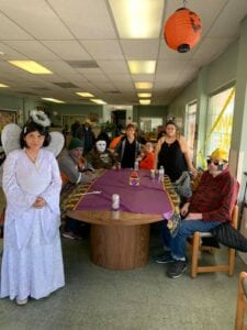 Special needs adults in costumes for a party