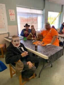 Specials needs adults at table having fun on Halloween