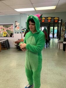 Special needs man in dragon costume at Halloween party