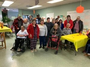 Special needs adults smiling for a group photo