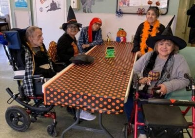 Elderly folks dressed up for Halloween party