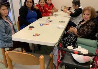 Elderly women having fun playing games in assisted living