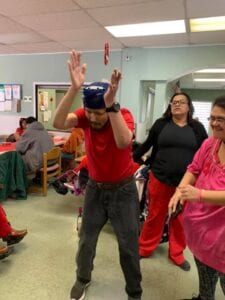 Special needs man dancing at Valentines day party