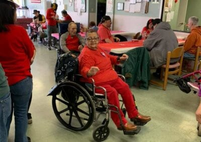 Woman in a wheelchair having fun on Valentines day