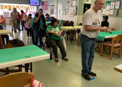 Adults lining up to play a game on St Patrick's Day