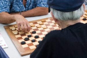 Elderly men playing checkers